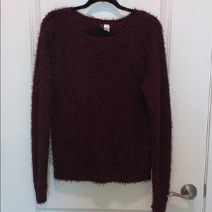 H&M divides fuzzy pullover sweater